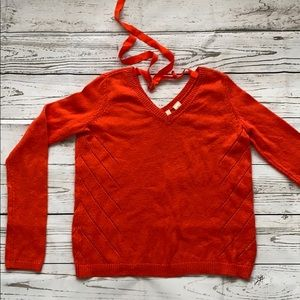 Bright orange sweater from Anthropologie